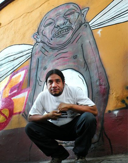 César Chávez in front of his grafitti mural Oaxaca, 2011/