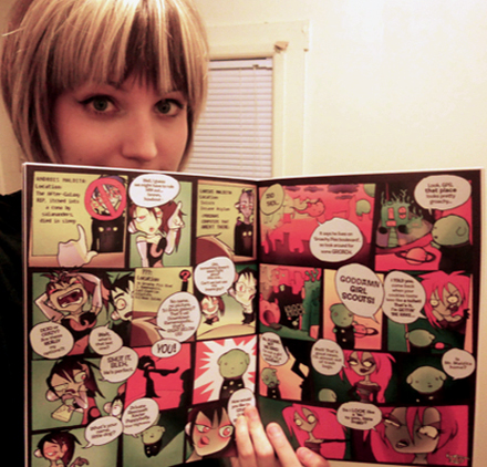 Hannah Stephey holding her comic