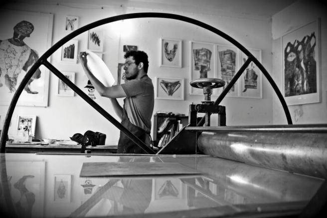 Javier checking a proof. Photo by Tirso Pérez.