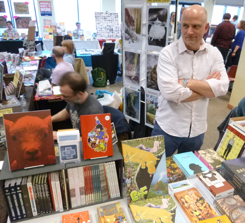 Chris Pitzer manning AdHouse books table at PIX.