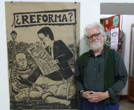 Kevin McCloskey with one of his woodblock prints at Espacio Zapata, Oaxaca.
