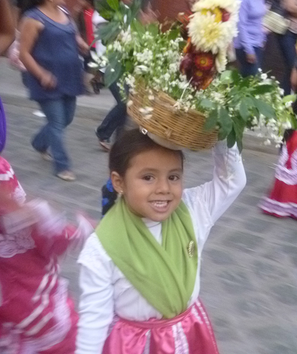 Young girl in one of Oaxaca's many parades. photo ©K.McCloskey 2012