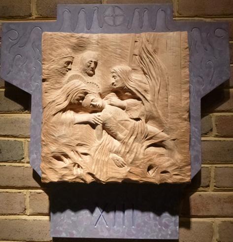 13. Jesus is taken down from the cross.
