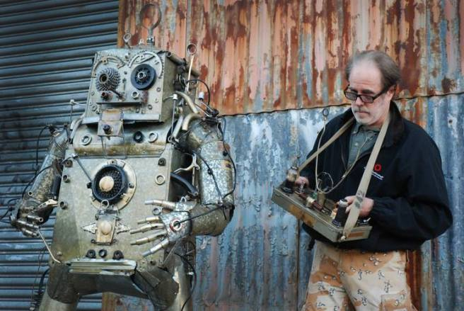 Robot 42 and his creator Chris Spollen. Photo © Chris Spollen
