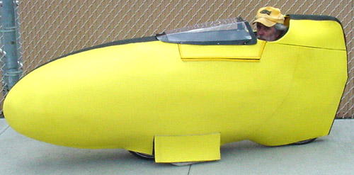 "Chris in the ""VEE BEE,"" his HPV, or Human Powered Vehicle"