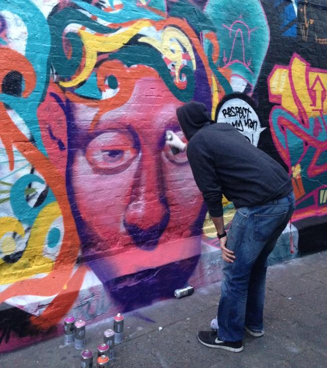 Matthew Dawn at work in Graffitti Alley.