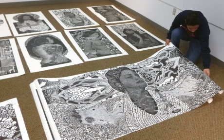 Alan Altamirano preparing his prints for display at Kutztown University. photo: K . McCloskey